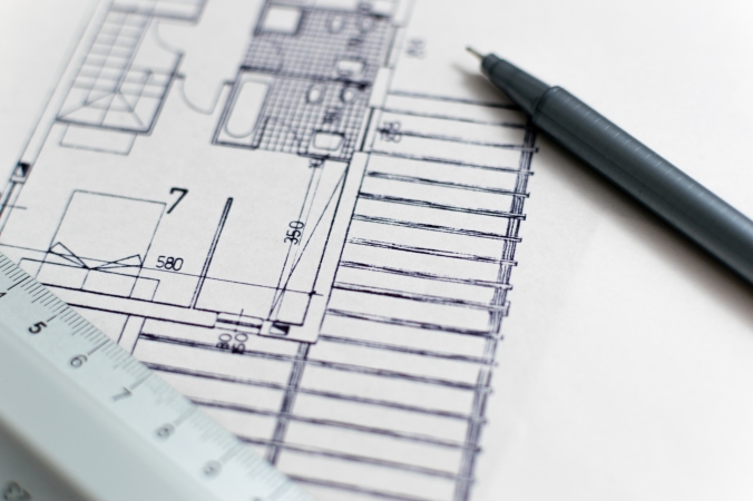 Architecture blueprint with pen and ruler
